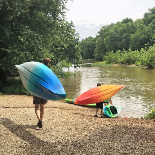 Staff Carrying Kayaks to the river